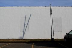 Berwick, NS (Avard Woolaver) Tags: light shadow sky canada colour topf25 grass car wall photo spring parkinglot flickr novascotia pavement s