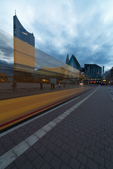 whoosh (maxelmann) Tags: germany tram sigma leipzig augustusplatz sachsen 12mm mdr 1224 haltestelle dhl straba uniriese sigma1224mmf4556exdghsm strasenbahn paulinum maxelmann