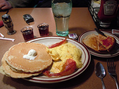 Denny's Breakfast (testpatern) Tags: food orange water glass pancakes breakfast table bacon big juice toast egg north plate eat butter american meal eggs brunch jelly syrup pancake ate dennys jam dakota scrambled minot breakie