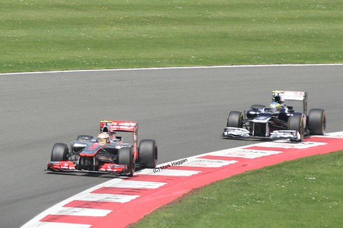 Lewis Hamilton in his McLaren leading Pastor Maldonado in his Williams at the 2012 British Grand Prix at Silverstone