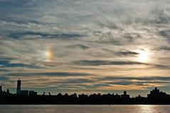Sun Dog (Chris Protopapas) Tags: newyorkcity sunset sun skyline architecture clouds pentax manhattan eastriver sundog atmospheric phenomenon freedomtower pentaxk10d smcpda1855mmf3556 justpentax pentaxart visipix
