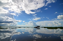 Between two skies (amirjina) Tags: sky lake reflection boat flood bangladesh wetland 2012 haor srimongal sreemangal sreemongal