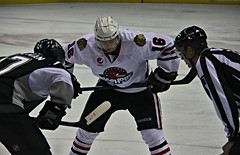 Face Off (spincast1123) Tags: county red chicago black cold building ice hockey sport sanantonio canon circle logo illinois official team hands san uniform indian helmet bank center swedish event gloves rink blackhawks stick bmo 16 harris faceoff iceskates antonio grip skates professionals rockford winnebago swede rampage svenska affiliate linesman arean icehogs 40d marcuskruger spincast1123