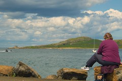 Lady in waiting (gerrydownes1) Tags: howth harbour port lady watching boats water sea rocks sailing mountain bay waiting yacth sailboat