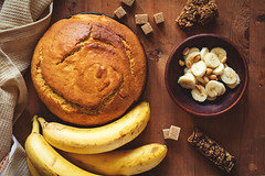 Homemade banana bread (Arx0nt.) Tags: wood morning food home yellow cake horizontal fruit breakfast bread cuisine golden wooden healthy bars rustic walnut nuts tasty fresh biscuit domestic homemade peanut loaf cooked product granola toned baked cookery filtered