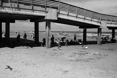 Port Arnasas, TX (the young pretender) Tags: street bridge people seagulls black beach water monochrome kids canon coast pier sand texas tx streetphotography andwhite 6d 3rdcoast portarnasas