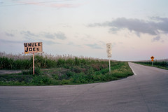 (patrickjoust) Tags: unclejoe hendrycounty florida fujicagw690 kodakportra160 6x9 medium format 120 rangefinder 90mm f35 fujinon lens manual focus analog mechanical c41 color negative patrick joust patrickjoust south fl usa us united states north america estados unidos autaut rural sugarcane farming agriculture sticks dusk sunset fields cable release tripod uncle joes sign road clouds