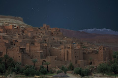 At Benhaddou. Full moon under the stars. (fischerfotografie.nl) Tags: city longexposure travel trees building tourism architecture fairytale night stars photography one ancient village nightshot ben palm morocco galaxy maroc marocco destination highlight thousand marokko kasbah benhaddou at haddou hadou