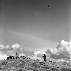 Kite (polarisandy) Tags: uk blackandwhite bw cloud mountain kite tlr monochrome yellow clouds rolleiflex vintage mediumformat square iso100 scotland britain 66 squareformat vintagecamera medium groundlevel 100 delta100 yellowfilter planar twinlensreflex ullapool ecosse stoer selfdeveloped 75mm environmentalportrait ilforddelta100 homedeveloped 35f trigpoint ddx fromtheground primelens frankeheidecke synchrocompur givenlight heidosmat