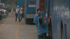 Factory workers catch the bus in Malaysia (War on Want) Tags: sweatshops waronwant