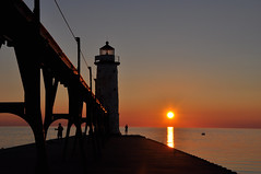 Manistee Lighthouse at sunset (Katy Silberger) Tags: sunset lighthouse silhouette catwalk manisteemi manisteelighthouse colorphotoaward nikond90 manisteenorthlighthouse