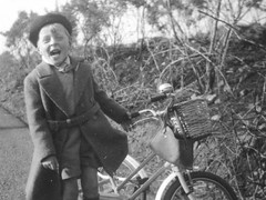Trike on the grass (theirhistory) Tags: boy grass hat bag child bell tricycle coa