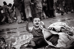 The Baby in Har-ki-pauri (Satyaki Basu) Tags: street travel people baby india canon eos indian 1750 tamron bnw ki ganga har ganges ghat hardwar explored pauri 450d gettyimagesmiddleeast