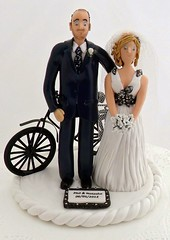 Phil & Natasha 2 (pauline@weddingtreasures) Tags: bike cake groom bride figurines handcrafted toppers newlyweds personalised caketoppers manandwife groomssuit bridesflowers weddingcaketoppers
