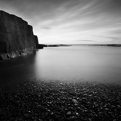Black Gold (Jeff Vyse) Tags: longexposure sea blackandwhite cliff pebbles mining coal blackgold