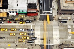 Intersection (egami obscura | www.egamiobscura.com) Tags: nyc longexposure newyork motion yellow nikon traffic manhattan taxi midtown intersection cabs taxicabs 2470mm d90