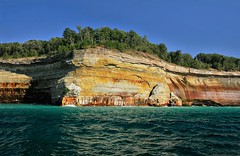 . pictured rocks . (susanonline (busy these days)) Tags: trees cliff lake cold water wisconsin golden turquoise greatlakes layers refreshing lakesuperior picturedrocks susanonline