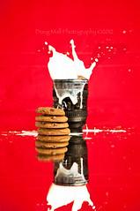 Cookie Splashdown (Doug.Mall) Tags: red reflection cup milk cookie splash funfunfun nikond5000 clichésaturday dougmall getpushed