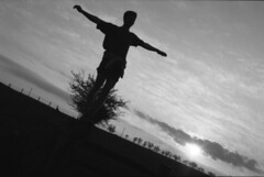 Sunset... not in Rio (Joybot) Tags: sunset shadow bw cloud sun white black film field silhouette 35mm outside outdoors person 50mm one cross arms bright jesus single setting fujica individual jessops pan100 jessopspan100 stx1n bwfp