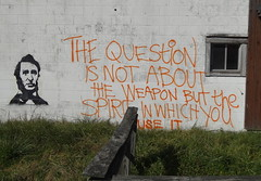 stencil hendersonville road the question weapon.jpg (zen) Tags: building graffiti words stencil weapon arden thoreau thequestion zensutherland hendersonvilleroad 20121105