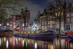A blue boat with yellow windows (karinavera) Tags: longexposure travel netherlands colors amsterdam night reflections lights boat canals nikond5300