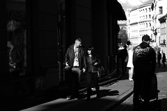 Hand in hand (mkorolkov) Tags: street city shadow people blackandwhite reflection love monochrome contrast walking hands couple walk candid streetphotography highcontrast fujifilm handinhand xe1 xc50230