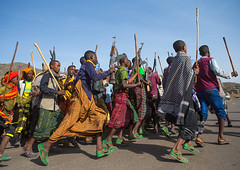 Oromo men with canes and kalashnikovs dancing during a wedding celebration, Oromo, Sambate, Ethiopia (Eric Lafforgue) Tags: africa wedding people color men horizontal religious outdoors togetherness sticks gun day african muslim islam joy culture marriage happiness celebration celebrations weapon canes guest ethiopia cheerful joyful adults celebrate groupofpeople enjoyment onthemove celebrating islamic weddingceremony developingcountry indigenous ethnicity traditionalculture hornofafrica happily eastafrica kalashnikov abyssinia worldculture realpeople onlymen fulllenght oromo cheerfully africanethnicity traditionalceremony lifeevent modernityandtradition sambate ethio161186