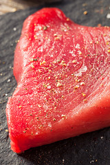 Raw Organic Pink Tuna Steak (brent.hofacker) Tags: pink red sea food fish cooking yellow japan vertical dinner sushi asian cuisine japanese healthy raw natural sauce portait knife fresh meat gourmet delicious slice steak meal fatty seafood sliced diet oriental bluefin piece tuna grilled ahi herb slices freshness nutrition dieting ingredient prepared tunasteak fillet uncooked yellowfin rawtuna