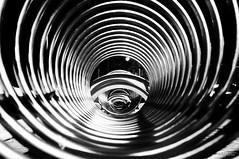 Il parcheggio (Ricardo Alguacil) Tags: bw white black byn blancoynegro blanco canon photography eos italia circles negro rimini 7d bici ricardo minimalismo abstracto redondo parcheggio cerchi circulos 2470 alguacil ricardoalguacil