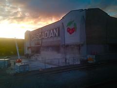 Sunrise over the Cascadian Fruit Company (rabidscottsman) Tags: railroad food building train sunrise cherry rail rr amtrak friday ios westbound 5c iphone empirebuilder appleiphone scotthendersonphotographysunrisefoodtravelamtrakrrrailroadempirebuilder