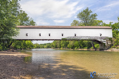Jackson Covered Bridge (Kenneth Keifer) Tags: wood old bridge trees red usa white nature clouds rural america creek vintage river landscape wooden midwest stream crossing unitedstates sightseeing scenic bank indiana bluesky jackson historic canoe american covered coveredbridge historical span rockville rockport yesteryear singlespan parkecounty nationalregisterofhistoricplaces coveredbridgefestival nationalregistryofhistoricplaces jacksonbridge jacksoncoveredbridge rockportcoveredbridge