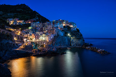 Cinque Terre (Raymond van der Zalm) Tags: blue sea italy reflection water coast hill salmon unesco creation hour terre manarola cinque