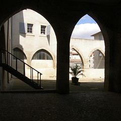 Arch Rivals II (Annie in Beziers) Tags: france stairs daylight shadows arches courtyard shutters restored streetscenes saintjacques romanarena bziers lesarenes centrehistorique historiccentre annieinbziers
