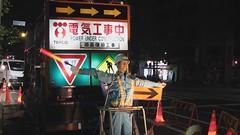 Traffic-bot is on the job (Sublight Monster) Tags: japan night japanese tokyo robot video construction kanji tsukiji 日本 東京 築地 chuo flagman 漢字 hiragana katakana カタカナ 日本語 中央区 ひらがな tepco