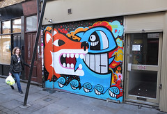 On Holiday, Everyday! (malarko) Tags: street fish pez brick art happy graffiti lane fox shutter malarky