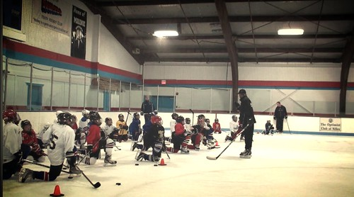 Brad Perry coaching a hockey school in Chicago  6