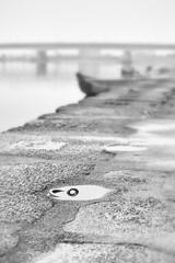 along the Nagara (StephenCairns) Tags: blackandwhite bw water rain japan canon river mooring highkey nocrop gifu  cormorantfishing    ukai  nagarariver   stephencairns  boatmoor canon5dmarkii  ukaifishingboat