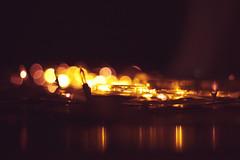 LIGHTS! (redaleka) Tags: light orange macro window lamp yellow closeup night reflections dark lights mirror evening focus candle dof darkness bokeh outdoor eid celebration celebrations reflect lamps ramadan tones celebrate fasting spreading