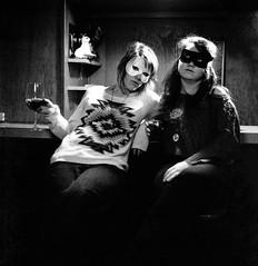 Masks (christait) Tags: party blackandwhite bw canada calgary 6x6 strange bar weird women katy wine drinking hasselblad masks alberta erica lovely yyc ilforddelta3200 500cm rodinal1100stand2hrs