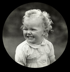 Smiling, blonde, curly haired child (State Library Victoria Collections) Tags: 1920s smile smiling 1930s 1910 1910s 1930 early1900s statelibraryofvictoria statelibraryvictoria nationalsmileday internationaldayofhappiness