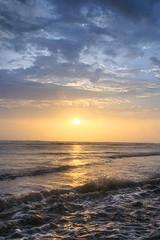 Warmth (abhishek.deopurkar) Tags: sunset sun clouds landscape warm waves dream