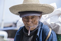 Dacang 796 (PEOPLEIMEET) Tags: life china street old travel people man eye hat race portraits photography one eyes shanghai faces time outdoor retrato no smoke border chinese beijing streetphotography smoking elder smokey  tradition yunnan dali stories minority region wrinkles ritratto tobacco tabak cina humans portre yi  portrat gabor  streetportraits  onerace  potret noborders chinatour hony   peopleimeet peopleinchina yizu oldfaces  dacang humansofnewyork humansof humansofchina humansofshanghai humansofbeijing