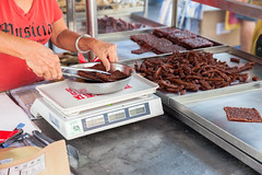 Woman weigh Chinese dried pork (Evgeny Ermakov) Tags: street food woman asian cuisine town george asia southeastasia hand market body traditional chinese dry georgetown meat pork exotic slice scales malaysia marketplace penang dried sliced tongs southeast weigh bodypart jerky weighing streetmarket bak wetmarket kwa bakkwa rougan