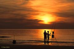 Angler - 06051602 (Klaus Kehrls) Tags: strand meer wasser sonnenuntergang himmel zeeland ostsee niederlande idylle angler cadzandbad