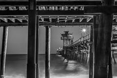Under the boardwalk... (Catching_alchemic light) Tags: ocean longexposure sea seascape tower landscape lights pier waves outdoor under lifeguard boardwalk sanclemente oceanscape sanclement