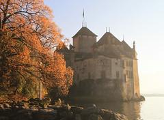 Autumn at Chillon Castle (` Toshio ') Tags: autumn sunset sunlight lake tree fall water switzerland rocks europe european jetty medieval shore chillon lakegeneva lacleman toshio chilloncastle