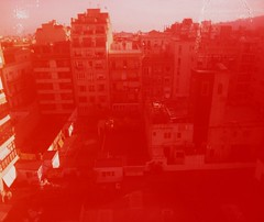 Rojo (teaselbrush) Tags: shot film camera toy superheadz slim white angel widescreen wide angle glitch blur photography barcelona spain urban city sun overexposed overexposure red blocks towers towerblocks