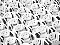 Ready and waiting (Claire Wroe) Tags: bw white lake black monochrome grass grey mono chair pattern seat hill gray row plastic slovenia bled straza