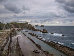Arna (Dea) Tags: sea sky beach clouds coast mar spain olympus e3 cantabria mogro arna covachos fola