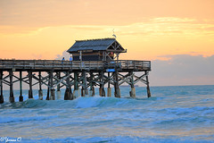 early morning at the Cocoa Beach Pier (Yvonne Oelsner) Tags: ocean sky orange beach water clouds strand contrast sunrise landscape pier meer wasser waves florida himmel sonnenaufgang wellen cocoabeach cocoabeachpier